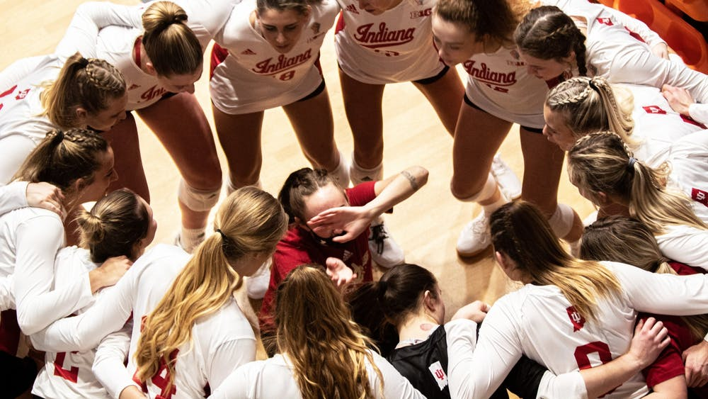 IU volleyball players circle up before a match Feb. 13 in Wilkinson Hall. The Hoosiers will play a double header this weekend against Michigan in Ann Arbor, Michigan.