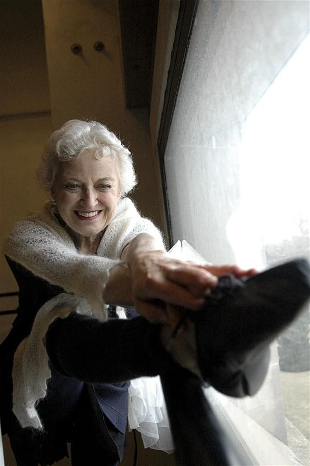 <p>Ballet professor Violette Verdy stretches on a barre Feb. 10, 2009, at the Musical Arts Center. Verdy, a native of France, received the Kathy Ziliak Anderson Chair in Ballet.</p>