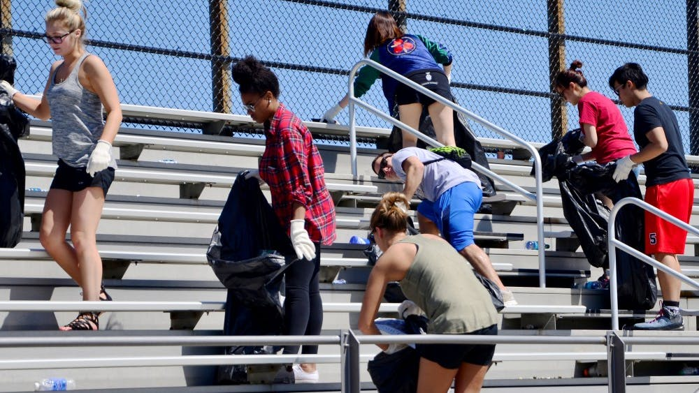 Students who have received a drinking violation ticket during the Little 500 weekend pick up trash as a part of the pretrial diversion program in 2016 at Bill Armstrong Stadium. Little 500 will take place this coming weekend with the women's race Friday at 4 p.m. and the men's race Saturday at 2 p.m.