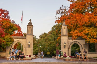 People walk and sit Oct. 10 around the Sample Gates.