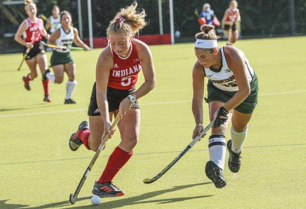 <p>Then-freshman forward Hailey Couch keeps the ball away from Michigan State back Baily Higgins on Oct. 5, 2018, at the IU Field Hockey Complex. Indiana will play the No. 9 Maryland Terrapins on Friday at the IU Field Hockey Complex.</p>