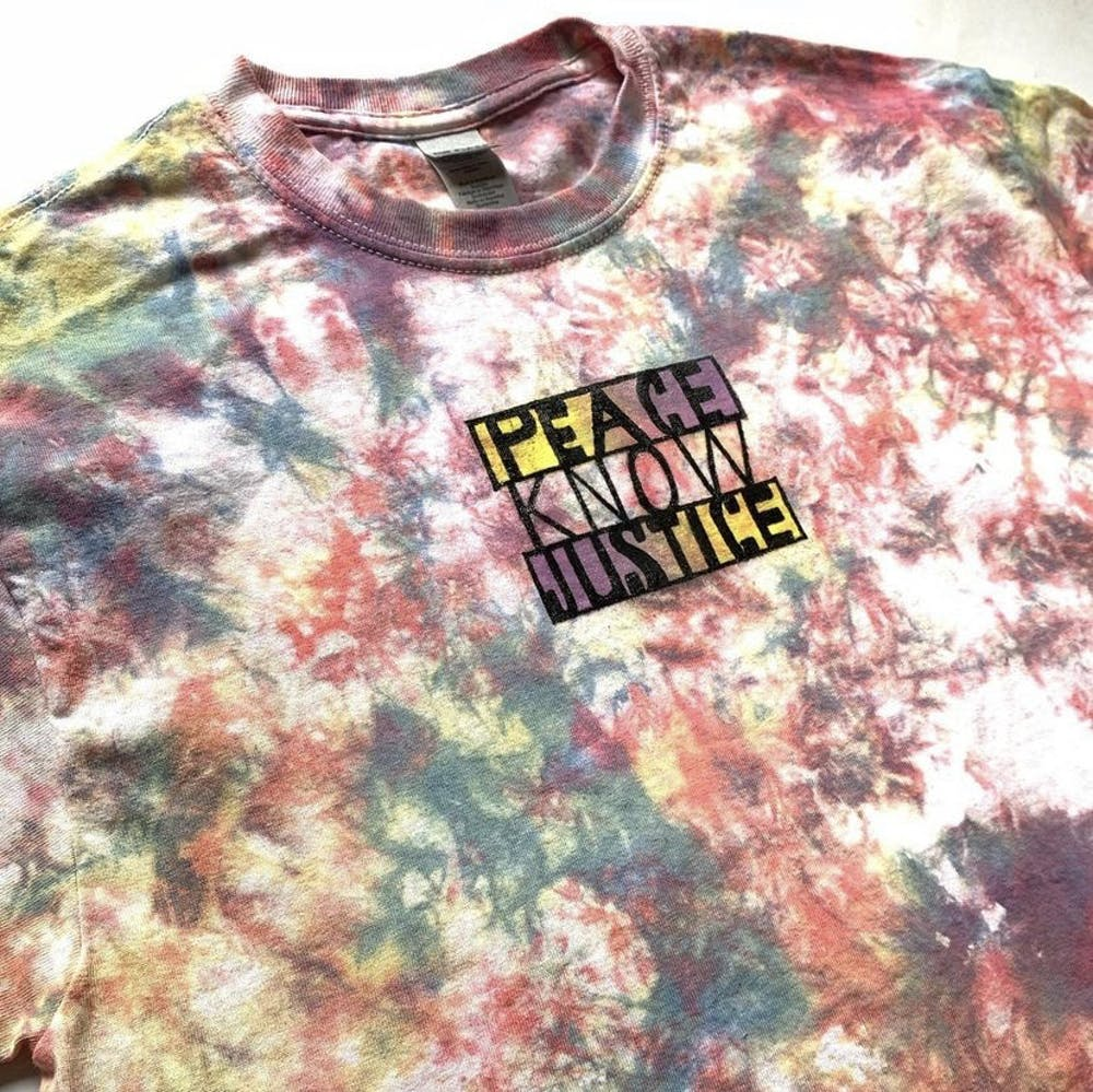 <p>Harriet Watson, owner of Harriet Watson Art and creator of the pictured t-shirt, will sell her art at the Bloomington Handmade Market on Kirkwood Avenue on Saturday.</p>