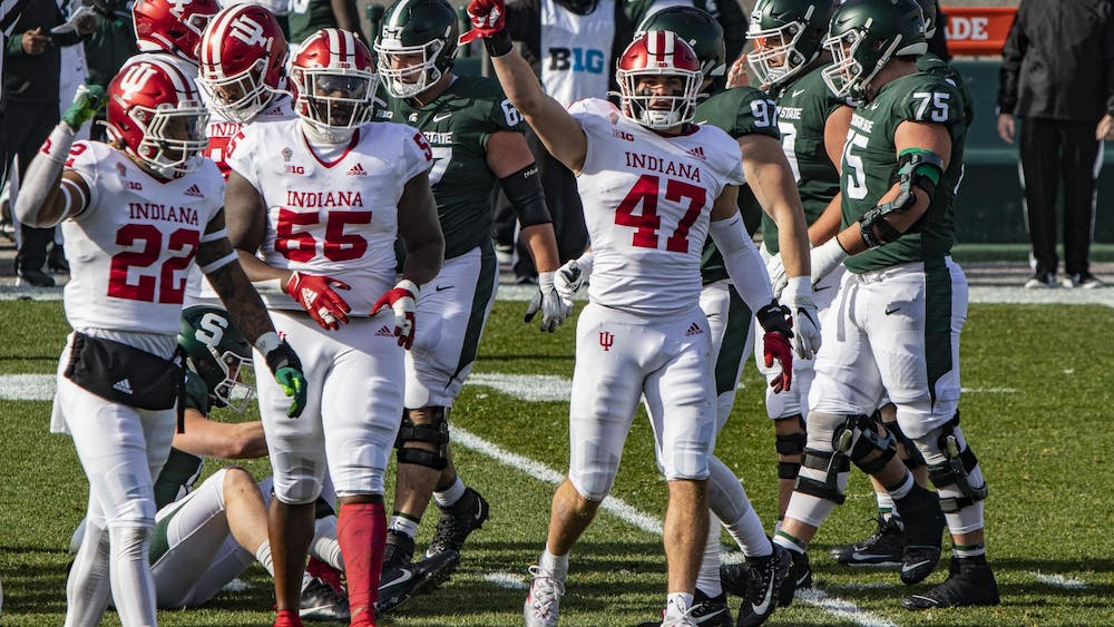 Then-junior linebacker Micah McFadden puts his fist in the air in the first quarter against Michigan State on Nov. 14 in Spartan Stadium in East Lansing, Michigan. McFadden were named to the watch list for the Chuck Bednarik Award after leading the Hoosiers with 58 tackles and six sacks.