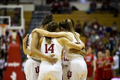 IU women's basketball huddles up before their game Dec. 15 at Simon Skjodt Assembly Hall. IU beat Penn State Jan. 23, 76-60.