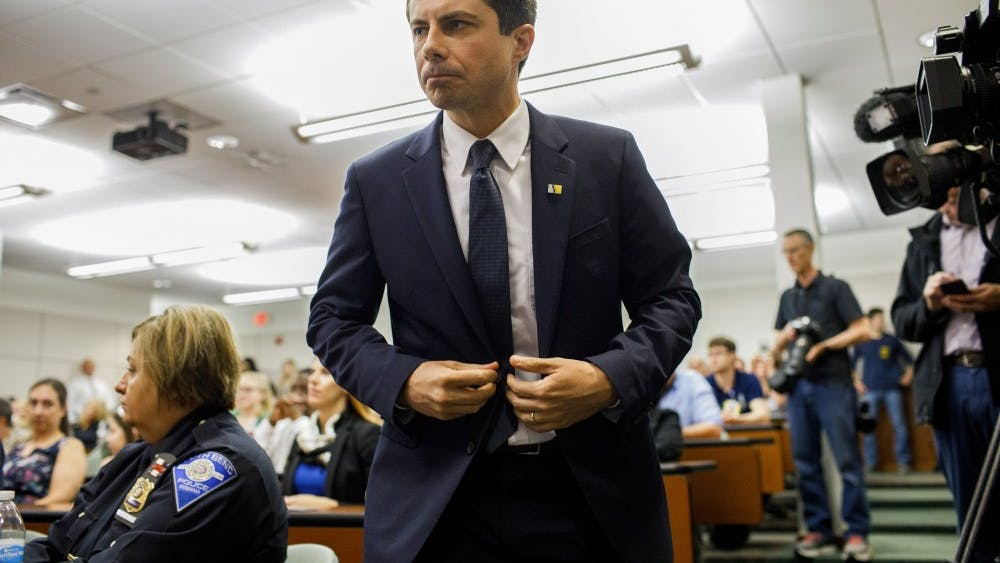 South Bend Mayor and 2020 presidential candidate Pete Buttigieg attends a board of public safety swearing-in ceremony at the South Bend Police Department Wednesday June 19, 2019, in South Bend, Indiana. Buttigieg is navigating fallout after a white police officer shot a black suspect.