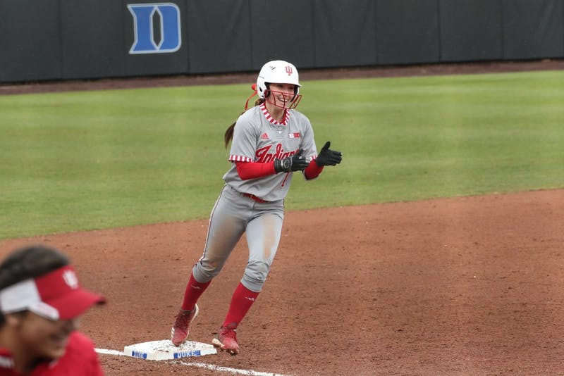 Sophomore Camryn Woodall celebrates Feb. 17 during the game against Syracuse University. Woodall started at second base and was No. 2 in the batting order.
