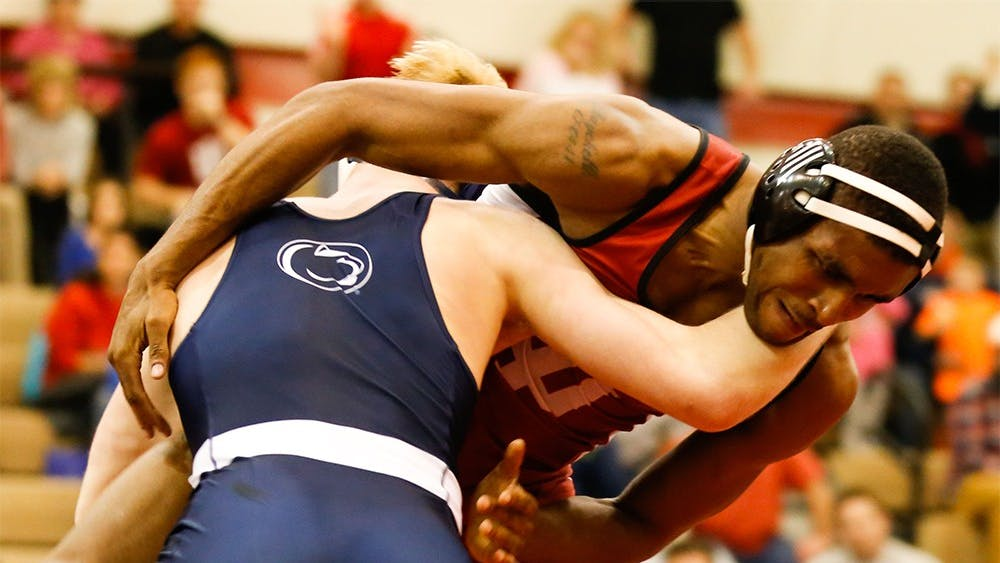 Nate Jackson, right, has a 174 lbs match with Bo Nickal from Penn State Sunday at University Gym. Jackson defeated the top national ranker.