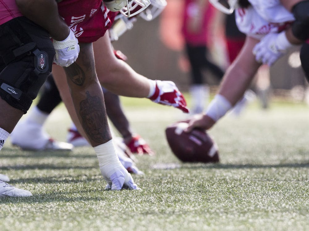 IU football players get into stance at the line of scrimmage Aug. 6, 2018, during practice. Former Stanford University player Jovan Swann committed to play his final year of eligibility at IU on Thursday.