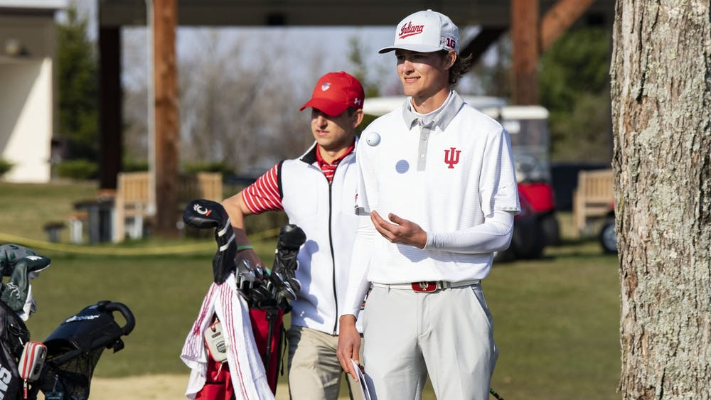 Senior Ethan Shepherd tosses a golf ball in the air before playing during the Hoosier Collegiate Invitational on April 4 at the Pfau Course. Men's golf tied for seventh on Sunday at the Robert Kepler Intercollegiate Columbus, Ohio.
