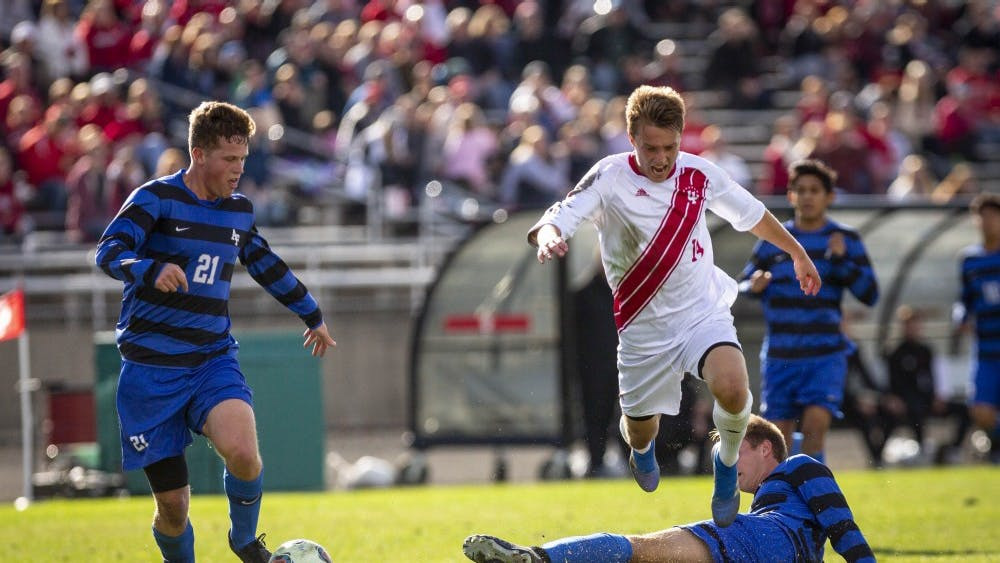Sophomore midfielder Griffin Dorsey is tackled while dribbling with the ball Nov. 25 during IU's third round game against the Air Force at Bill Armstrong Stadium during the NCAA Tournament. The Hoosiers defeated the Falcons, 2-0.