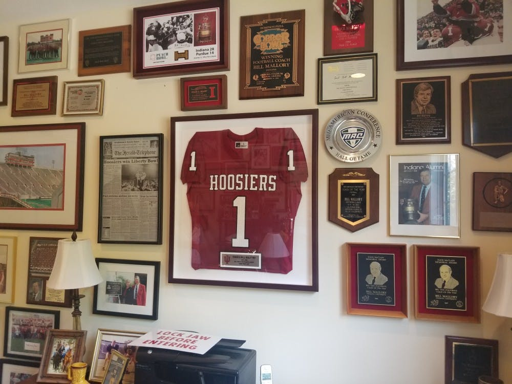 The walls of former IU football Coach Bill Mallory's office are covered in memorabilia from his career. Mallory was a collegiate head football coach from 1969 to 1996.