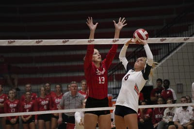 IU senior Jacqui Armer blocks a set against University of Tennessee Martin on Aug. 31 at Wilkinson Hall. IU beat Stetson University and the University of South Florida twice this weekend in Tampa, Florida.