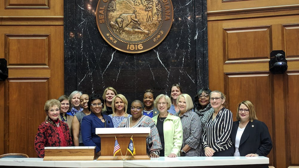 Members of the Indiana House Democratic Caucus stand in the State House. Female caucus members created a list of bills that introduced policies that relate to women in honor of the 100th anniversary of women being allowed to vote.