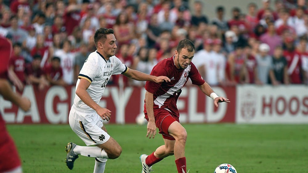 Then-junior, now senior defender Andrew Gutman dribbles the ball against Notre Dame on Sept. 26, 2017 at Bill Armstrong Stadium. No. 4 IU will travel to South Bend Tuesday night to take on No. 12 Notre Dame.