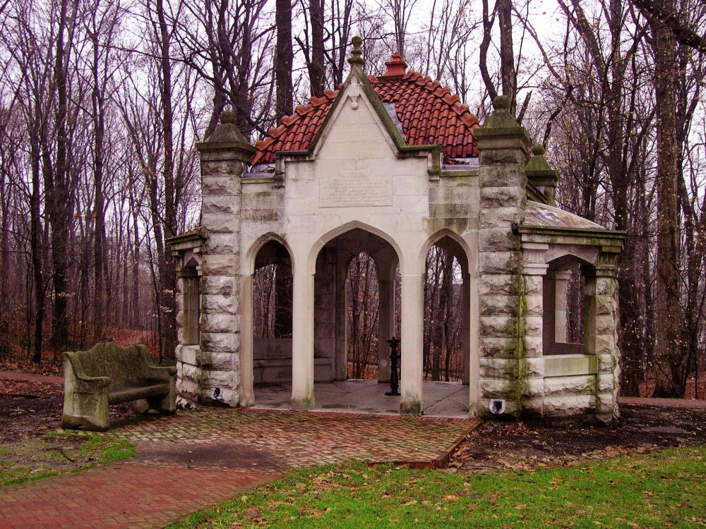 The Rose Well House is a small structure built in 1908 from stone door gates that were originally part of the Old College Building. The well house is located on the northeastern edge of Dunn's Woods.