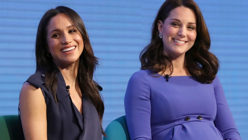 Meghan Markle, left, and Catherine, Duchess of Cambridge, attend the first Royal Foundation Forum on Feb. 28, 2018, in London.