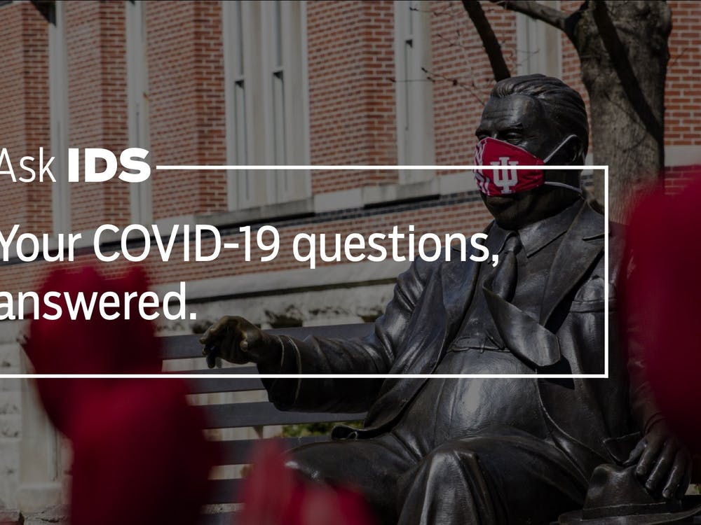 A face mask covers the face of the Herman B Wells statue April 20 on IU's campus.