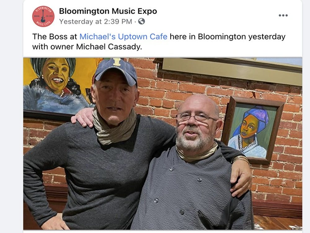 A photo from Bloomington Music Expo's Facebook page shows Uptown Cafe owner Michael Cassady posing with Bruce Springsteen on Saturday.