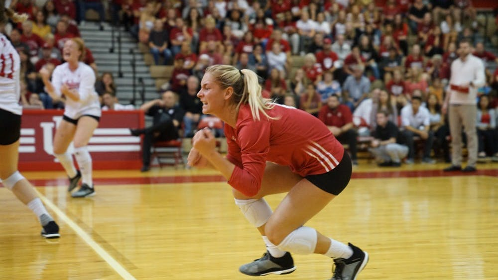 Sophomore libero Bayli Lebo celebrates after scoring a point against the Minnesota on Saturday night. The IU women's volleyball team lost to the Golden Gophers, setting their record to 11-4 for the season.