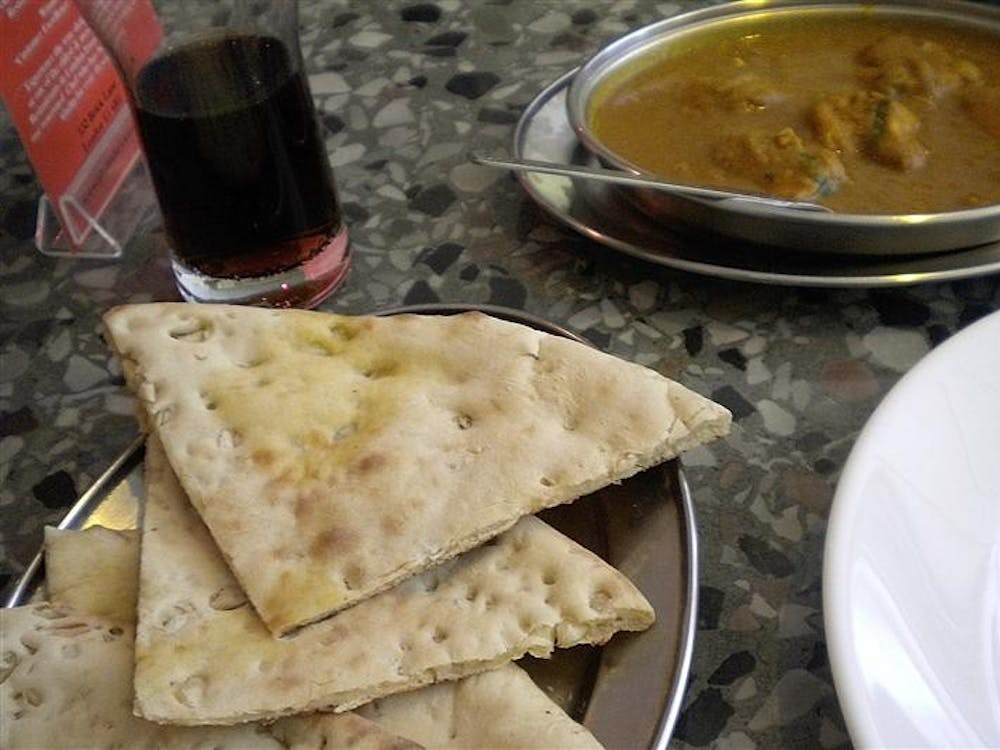The restaurant Aladin in London serves a vegetable curry with garlic naan, a traditional Indian flatbread.