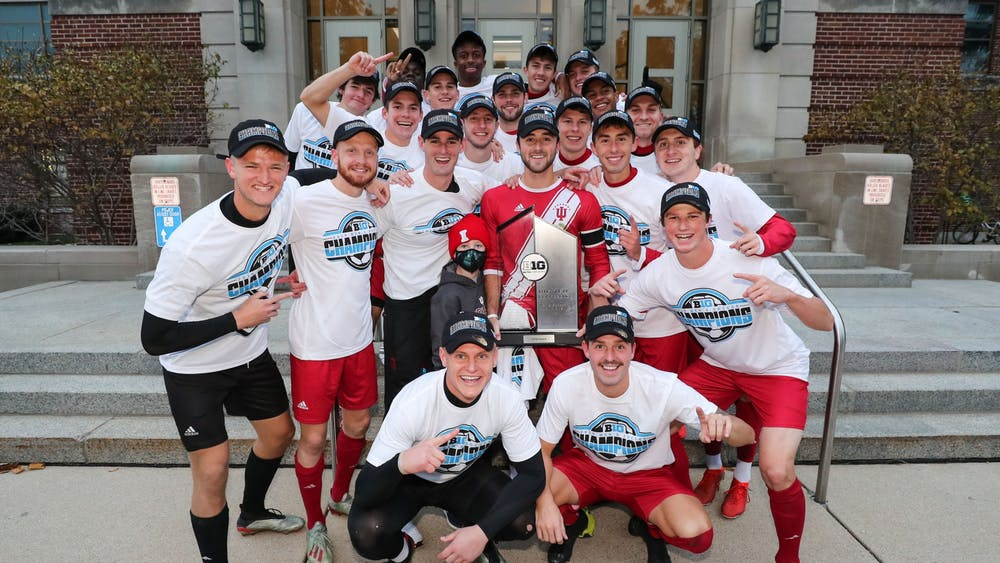 The IU men's soccer team poses with the Big Ten regular season trophy after defeating Michigan State on Nov. 3 in East Lansing, Michigan.