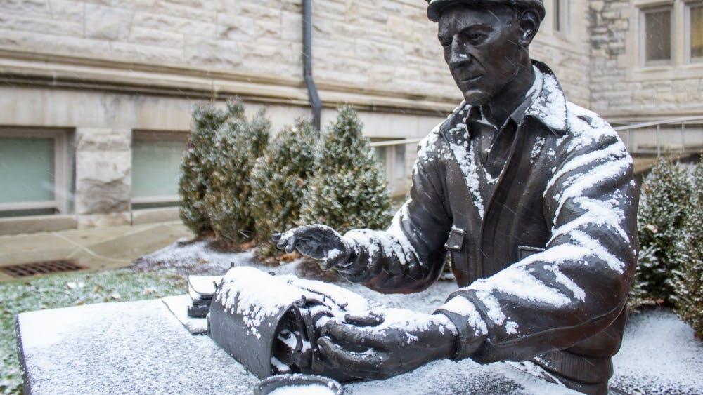 The Ernie Pyle statue located in front of Franklin Hall is covered in snow Nov. 26.