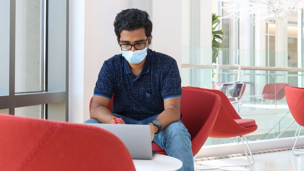 Graduate student Shakeel Ahamed studies Sept. 13, 2021, in Luddy Hall. The Fibers & Additive Manufacturing Enabled Systems Lab at the Luddy School of Informatics, Computing and Engineering has entered into a new research agreement on smart fiber technology with Bloomington-based medical device company Cook Medical.