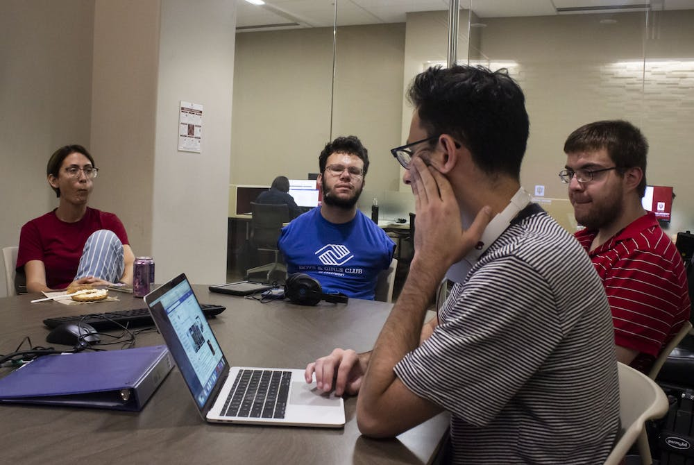 <p>IU student Ben Foley, Bloomington resident Hunter Cullen and then-student Abe Shapiro meet with visiting lecturer Nejla Routsong to discuss goals for the Neurodiversity Coalition on Sept. 27, 2019. </p><p></p>