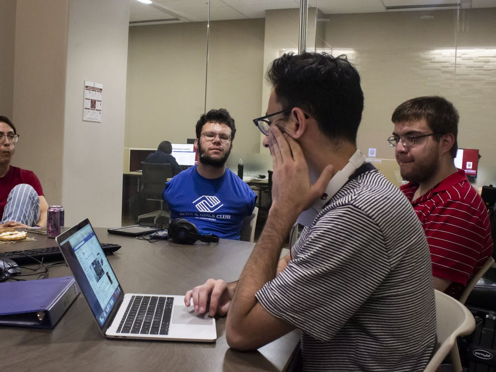 IU student Ben Foley, Bloomington resident Hunter Cullen and then-student Abe Shapiro meet with visiting lecturer Nejla Routsong to discuss goals for the Neurodiversity Coalition on Sept. 27, 2019.