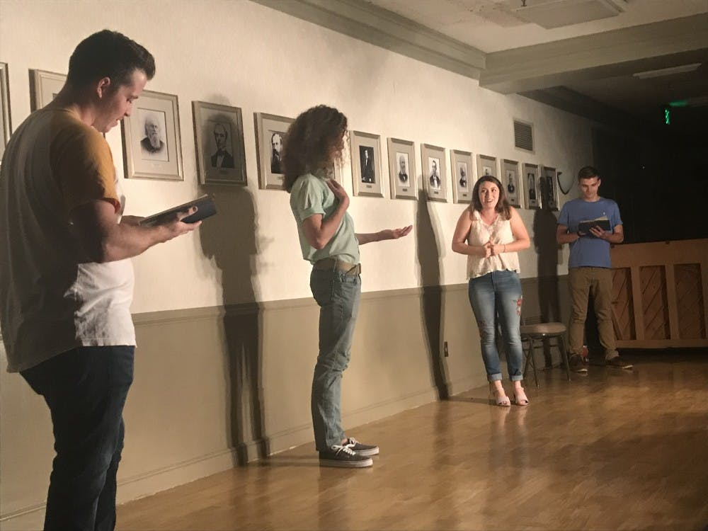 Full Frontal Comedy cast members play a short improv game Sept. 21 at their weekly show. In this game, two members read stage directions from different plays while the others try to incorporate the directions into an improvised skit.
