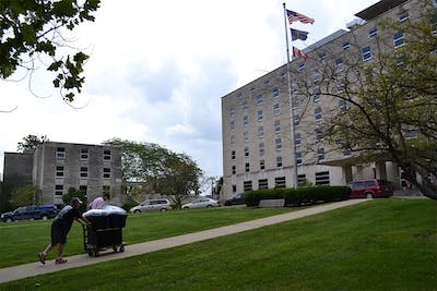 Students move into their assigned dorms Monday at Teter Residence Center.