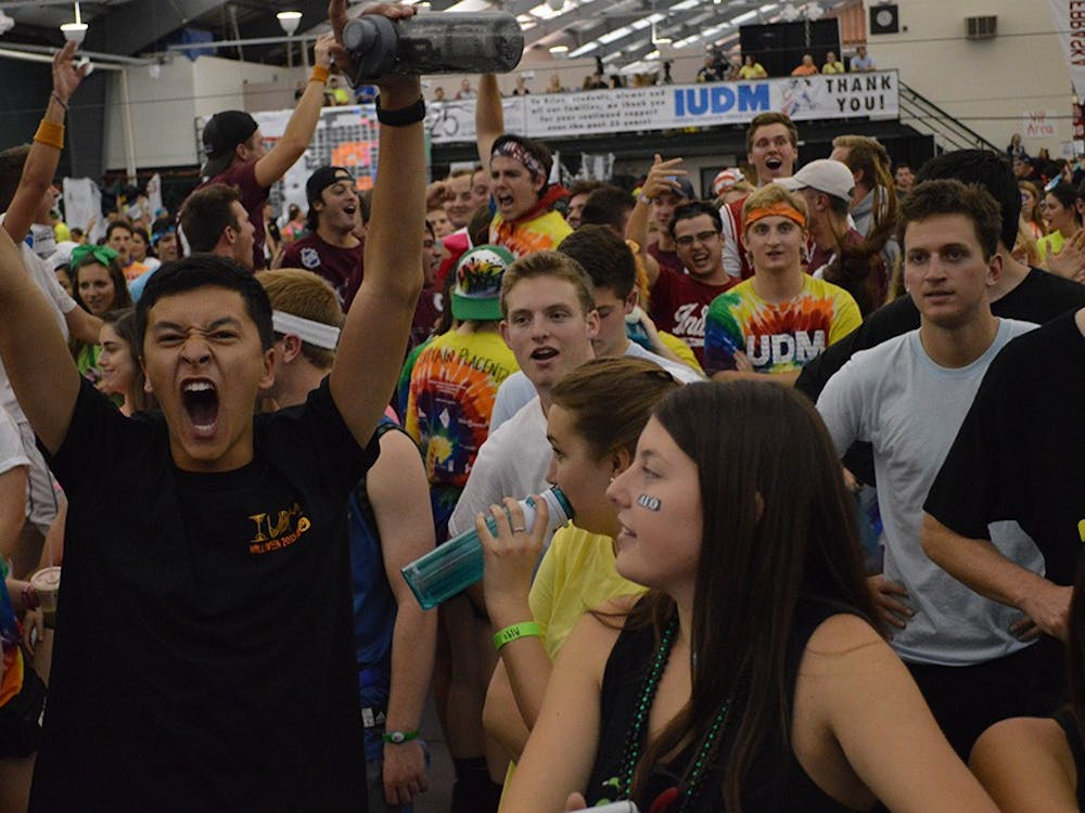 Sophomore Jaeson Chang screams after donations were made during the Indiana University Dance Marathon Saturday evening at the IU Tennis Center.