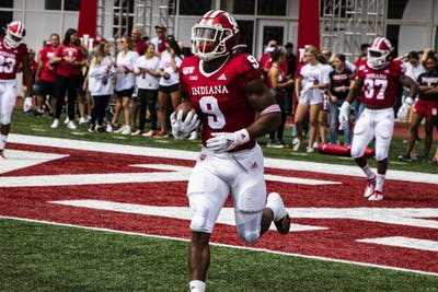 Redshirt junior defensive back Marcelino Ball runs with the ball during warmups Sept. 7 at Memorial Stadium. IU will play the University of Connecticut this weekend.
