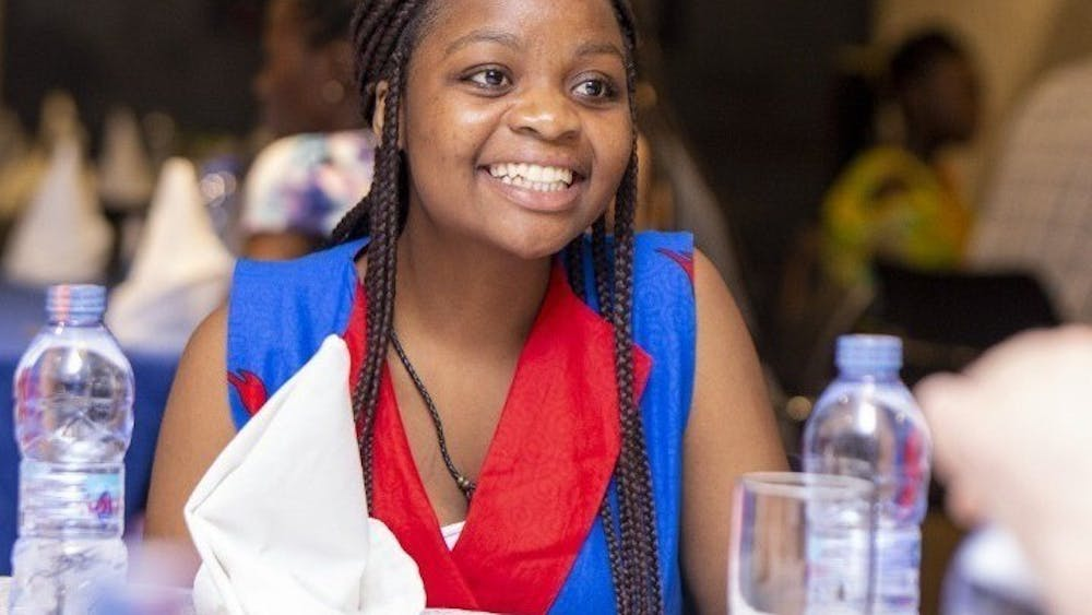 Writer Agness Lungu smiles in 2020 at a women's conference in Zambia. Lungu writes that the excuse of some African names being too difficult to pronounce may be erasing history.