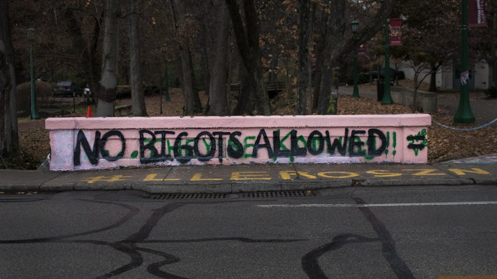 "One side of the bridge crossing Jordan Avenue near the Neal-Marshall Black Culture Center was painted to say, ""No Bigots Allowed"" sometime in the night between Nov. 20-21, 2019. The message is in response to Kelley School of Business professor Eric Rasmusen retweeting an article on Twitter stating women are ""destroying academia."""