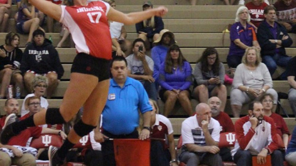 Kendall Beerman serves the ball in game two of the total three Saturday afternoon against against Evansville during the IU Volleyball game Saturday afternoon at University Gym.