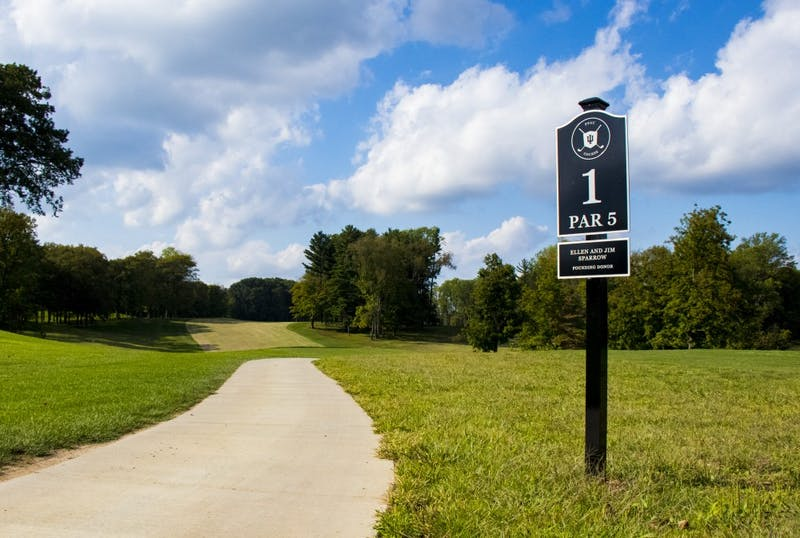 A path runs by the sign for the first hole at the Pfau IU Golf Course. The IU men's golf team had its best tournament of the season, finishing fifth out of 12 teams at the Marquette Invitational in Erin Hills, Wisconsin.
