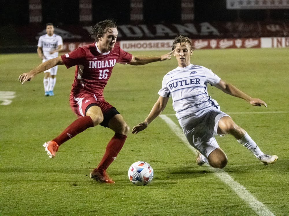 Sophomore defender Lukas Hummel attempts to dribble past a Butler University player during IU men's soccer's home opener on Aug. 31, 2021, at Bill Armstrong Stadium. Indiana will play Rutgers at 8 p.m. on Sept. 17, 2021, in Bloomington.