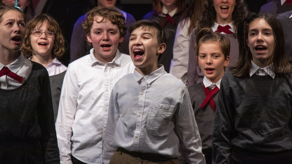 """The cast of """"Matilda the Musical"""" rehearses the song """"When I Grow Up"""" on March 2 in Whikehart Auditorium in the John Waldron Arts Center. Stages Bloomington, a theater company, will perform the musical March 5 to 8 in Whikehart Auditorium."""