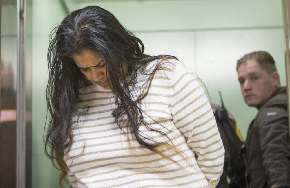 Purvi Patel is taken into custody after being sentenced to 20 years in prison for feticide and neglect of a dependent on March 30 at the St. Joseph County Courthouse in South Bend.