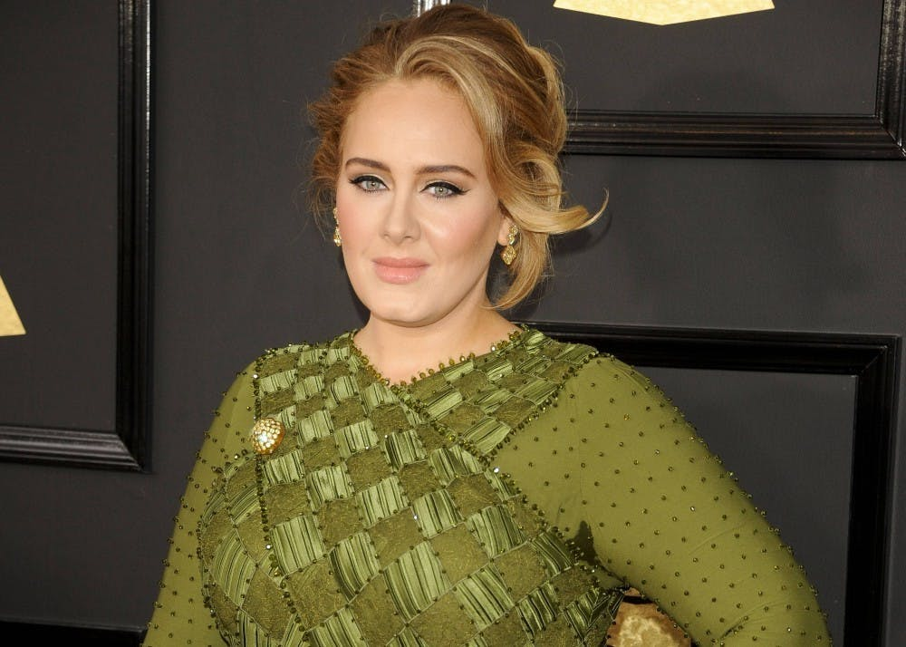 """<p>Adele poses for a picture at the 59th Annual Grammy Awards on February 12, 2017, in Los Angeles. Grammy Award-winner Adele announced her anticipated return to music after posting a 20-second snippet of her new single <a href=""""https://twitter.com/Adele/status/1445388436773425163?ref_src=twsrc%5Etfw%7Ctwcamp%5Etweetembed%7Ctwterm%5E1445388436773425163%7Ctwgr%5E%7Ctwcon%5Es1_c10&amp;ref_url=https%3A%2F%2Fwww.elle.com%2Fculture%2Fmusic%2Fa37867812%2Fadele-new-album-30-details%2F"""" target="""""""">""""Easy on Me""""</a> on Oct. 5.</p>"""