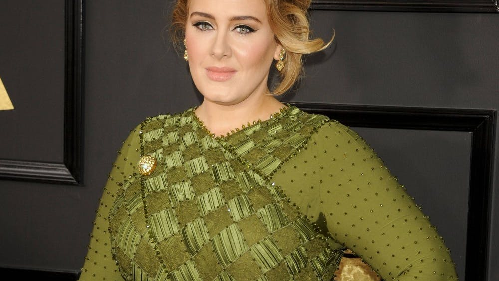 """Adele poses for a picture at the 59th Annual Grammy Awards on February 12, 2017, in Los Angeles. Grammy Award-winner Adele announced her anticipated return to music after posting a 20-second snippet of her new single """"Easy on Me"""" on Oct. 5."""