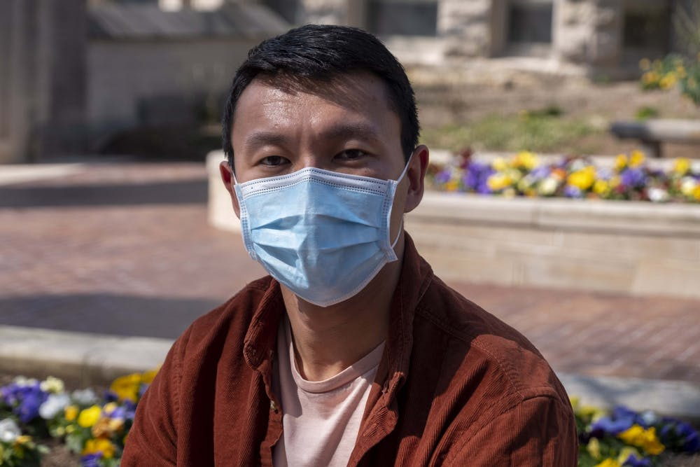 <p>Ardahbek Amantur, 29, is pictured outside of Sample Gates on Monday. Amantur immigrated to the U.S. for safety, but in February, he was the victim of a racist attack. </p>