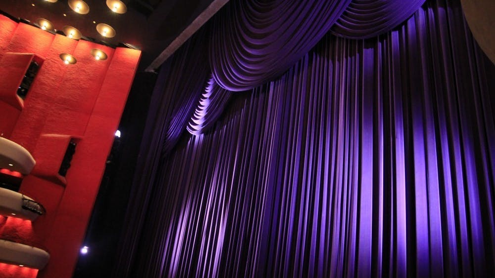 "The Musical Arts Center curtains have light shined on them before a rehearsal. ""Writing about the arts has allowed me to understand people's passions on a deeper level. The arts – whether it be music, movies, books or another medium – are a portal into someone's personal life,"" wrote columnist Ellie Albin."