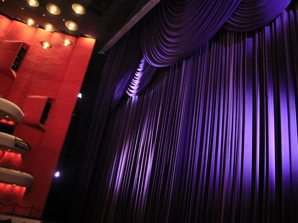 """The Musical Arts Center curtains have light shined on them before a rehearsal. """"Writing about the arts has allowed me to understand people's passions on a deeper level. The arts – whether it be music, movies, books or another medium –are a portal into someone's personal life,"""" wrote columnist Ellie Albin."""