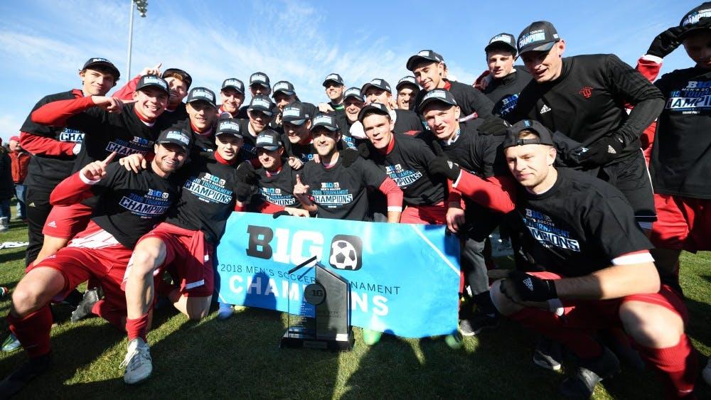 Indiana poses with the trophy after the game Nov. 11 at Grand Park during IU's championship game against Michigan during the Big Ten men's soccer tournament.