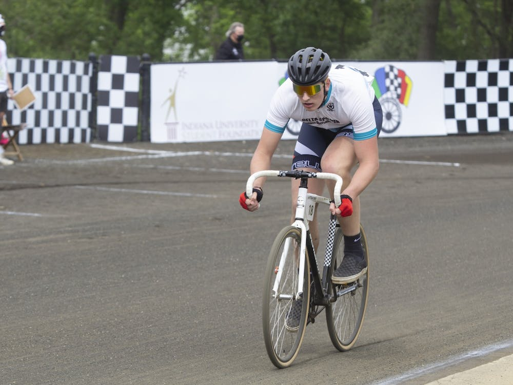 A Delta Upsilon rider races on the track during the men's Little 500 on May 26 at Bill Armstrong Stadium.