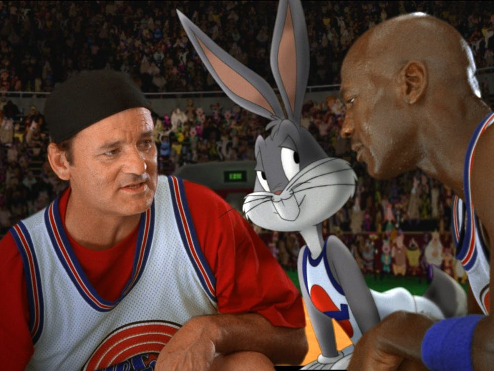 UNSPECIFIED - JANUARY 26:  Medium shot of Bill Murray as Himself wearing hat/baseball cap, huddled with Bugs Bunny and Michael Jordan; all wearing basketball uniforms in front of crowd. (Filmframe).  (Photo by Warner Bros./Getty Images)