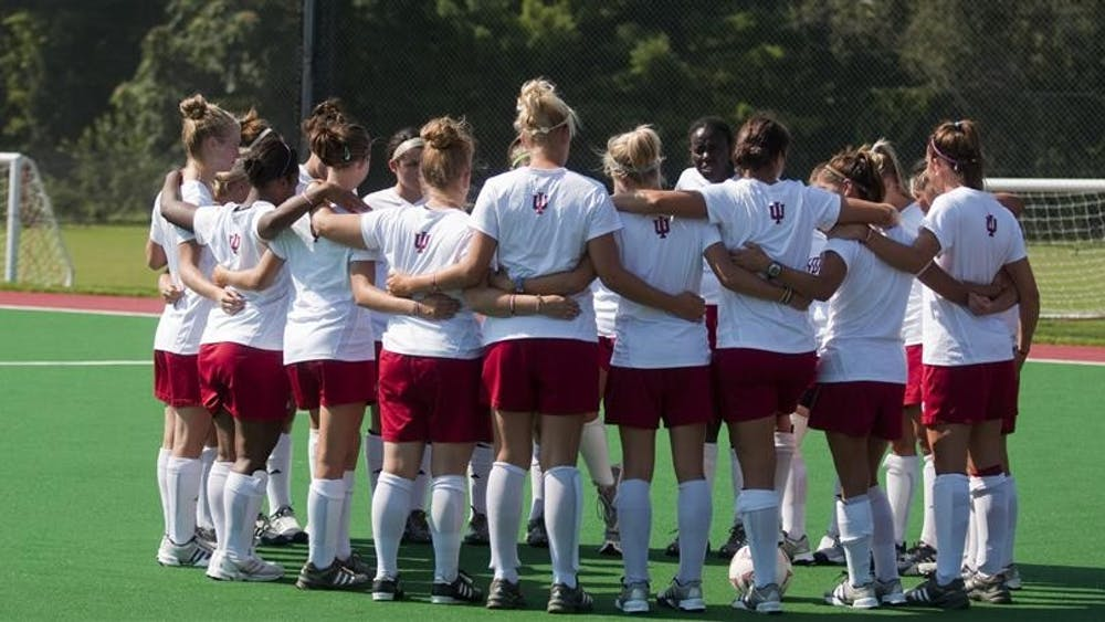 The IU Field Hockey team gets in a huddle before practice on Tuesday, Aug. 25, 2009.