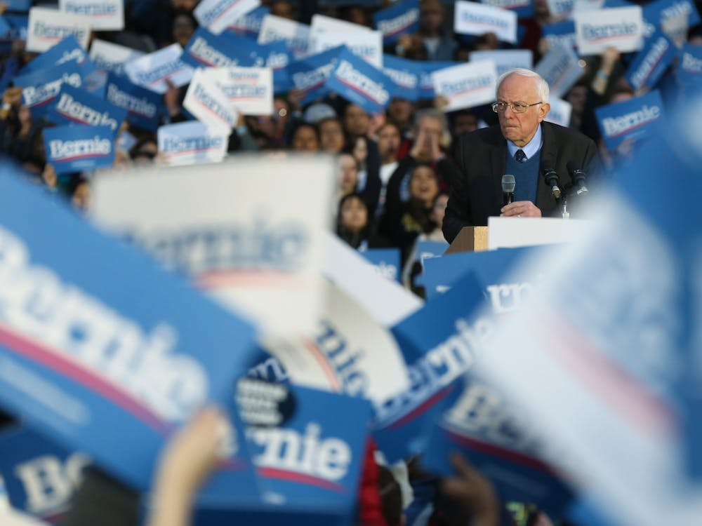 The crowd applauds as then-presidential candidate Sen. Bernie Sanders speaks during a rally at the University of Michigan main quadrangle on March 8 in Ann Arbor, Michigan.Sanders dropped out of the presidential race Wednesday.